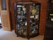 Glass n Crystal half round  cabinet.