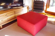 Ottoman,  never used. Dense foam,  upholstered  on MDF base.